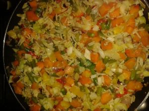 One spoon of rice added to sauteed vegetables for 3 adults